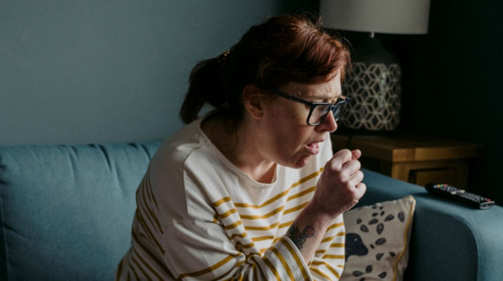 Woman coughing image
